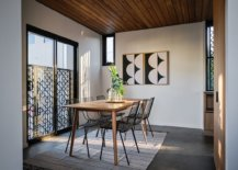 Modern-dining-room-with-a-flood-of-sunlight-wooden-ceiling-and-a-modern-minimal-table-and-chairs-74562-217x155