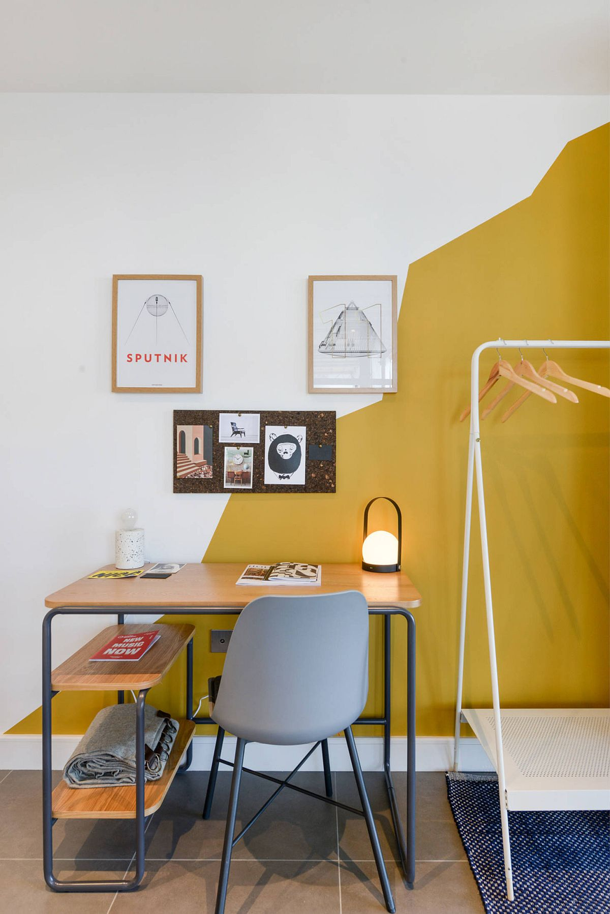 Modern eclectic home office with a white and yellow backdrop that steals the show