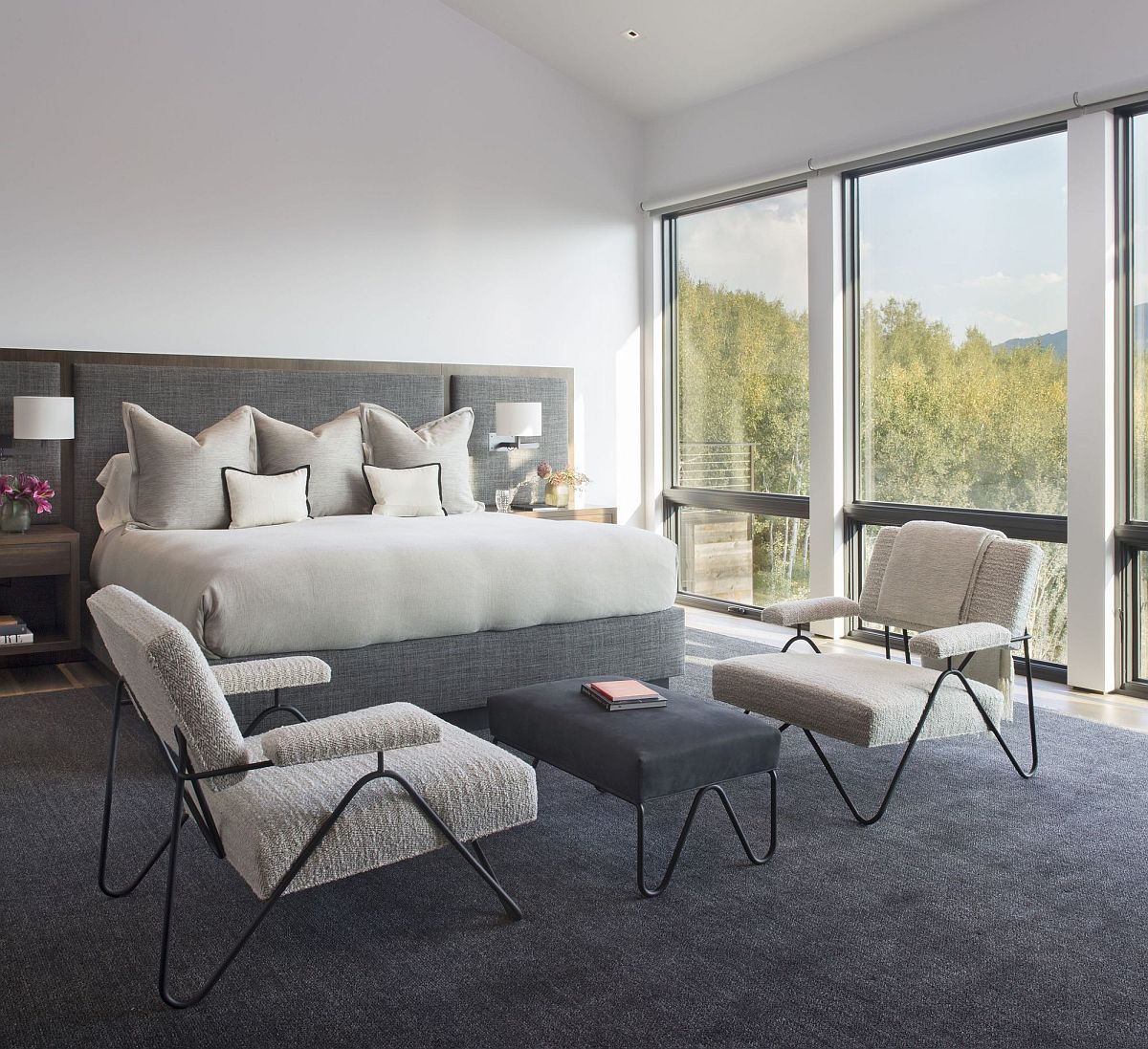 Modern gray and white bedroom with fabulou mountain views in the distance