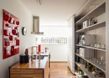 Modern-kitchen-with-red-accent-storage-system-and-stainless-steel-shelves-22433-217x155