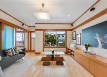 Modest-Japanese-style-living-room-in-wood-and-white-with-a-low-slung-couch-in-dark-gray-63069-217x155