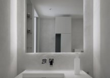 Modest-and-space-savvy-powder-room-with-minimal-style-and-a-neutral-color-scheme-79262-217x155