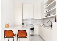Monochromatic-kitchen-in-white-of-apartment-in-Greenwich-with-bar-stools-that-provide-visual-contrast-64237-217x155