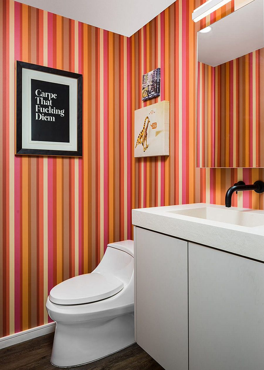 Multi-colored stripes on the walls brighten the small powder room without overwhelming it