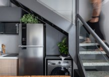 Old-staircase-of-the-house-was-remodeled-and-painted-gray-to-allow-it-to-fit-in-with-the-new-style-of-the-loft-84659-217x155