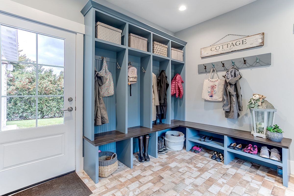 Open cubbies are a staple of the mudroom along with the bench that offers additional storage