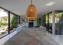 Open-plan-living-area-of-the-house-with-kitchen-and-dining-space-along-with-patios-on-both-ends-95548-217x155