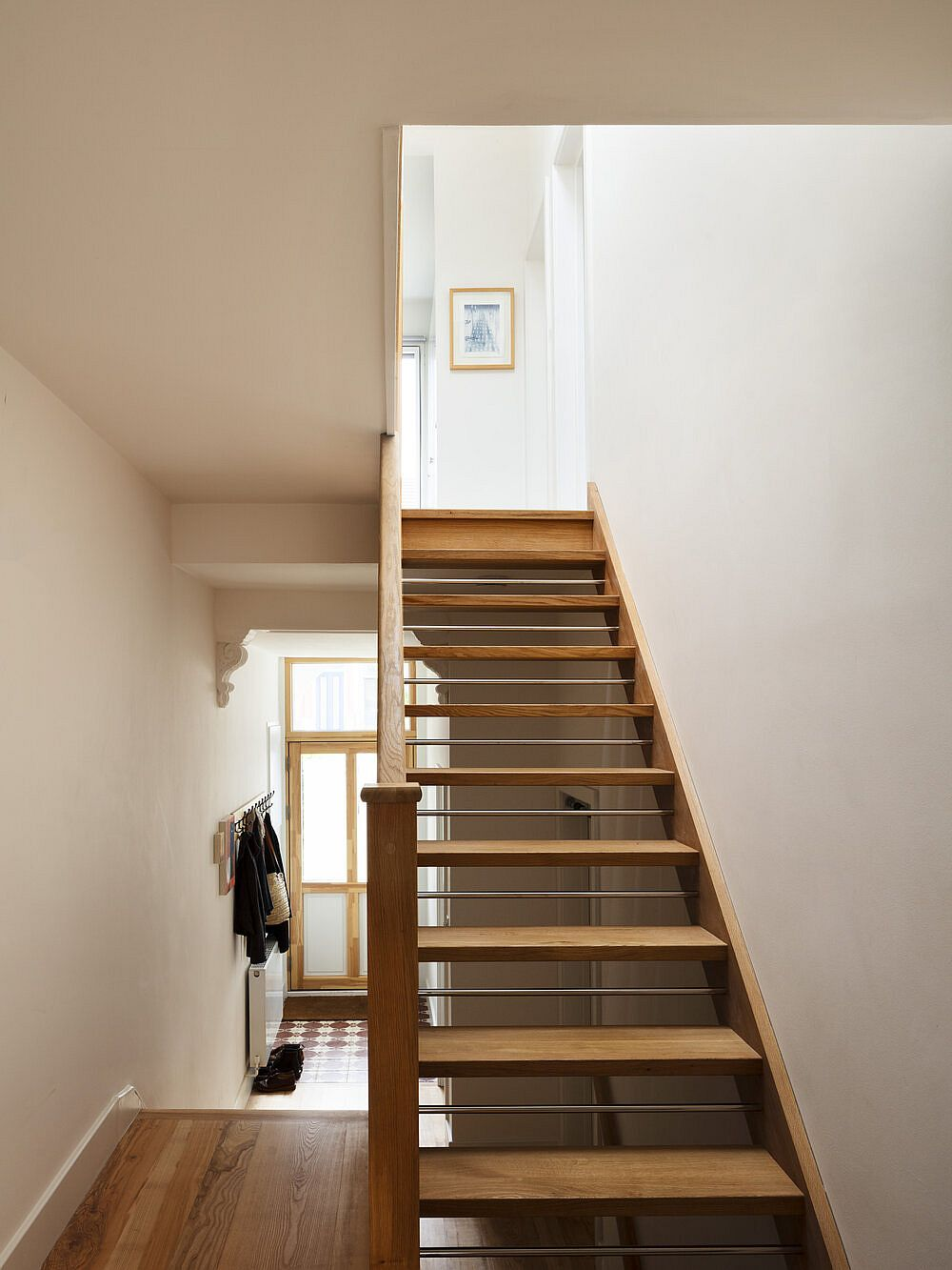 Open-tread timber staircase replaces the old stairway in the home