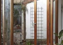 Opening-doors-brings-ventilation-into-the-small-and-revamped-workers-cottage-in-Melbourne-44930-217x155