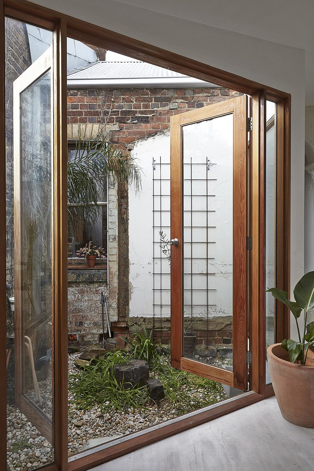 Opening-doors-brings-ventilation-into-the-small-and-revamped-workers-cottage-in-Melbourne-44930