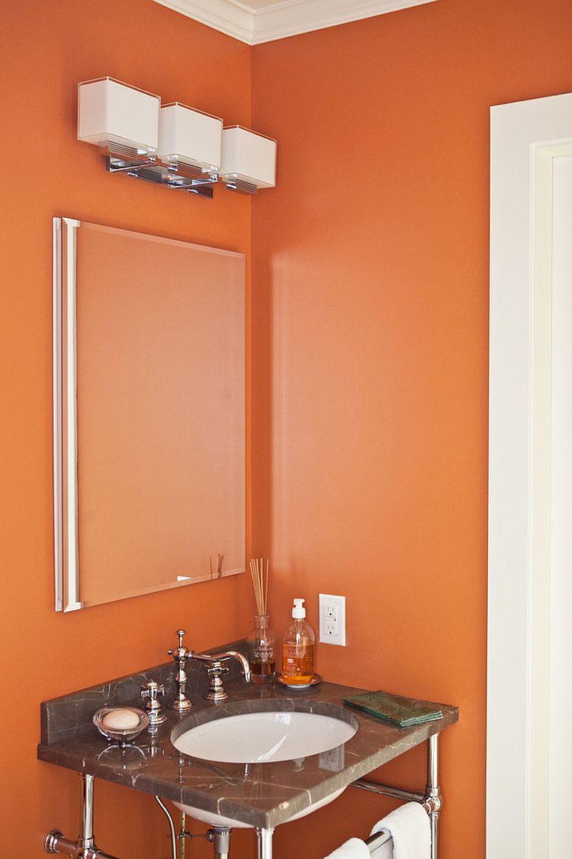 Orange white powder room of modern New York home