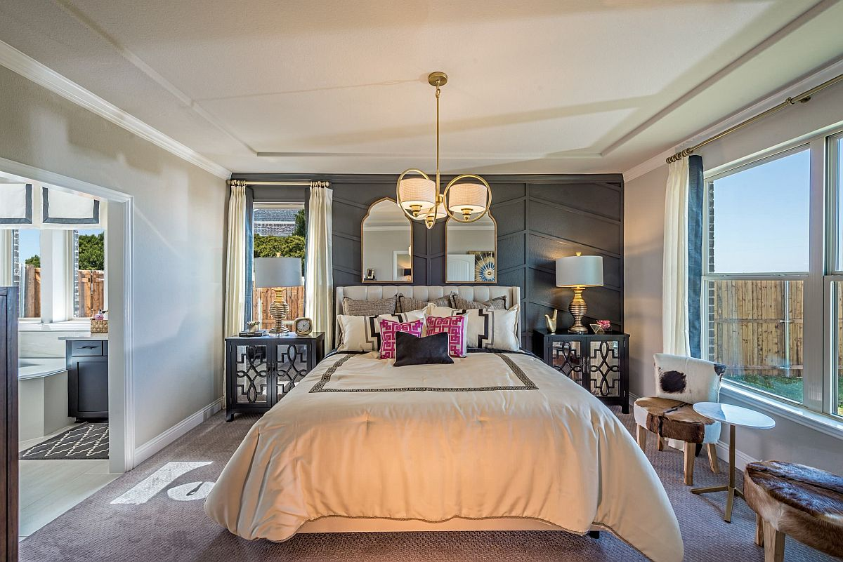 Ornate gray wall with pattern matches the glam of the bedroom!