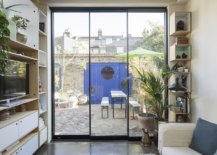 Patio-of-the-house-also-holds-a-new-studio-that-has-a-bright-blue-entrance-42196-217x155