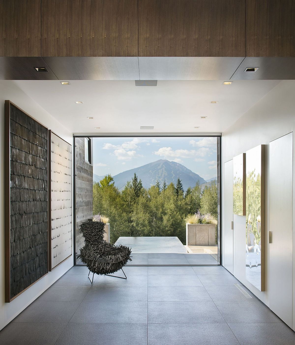 Picture window frame perfectly captures the view of distant mountains and the scenery beyond