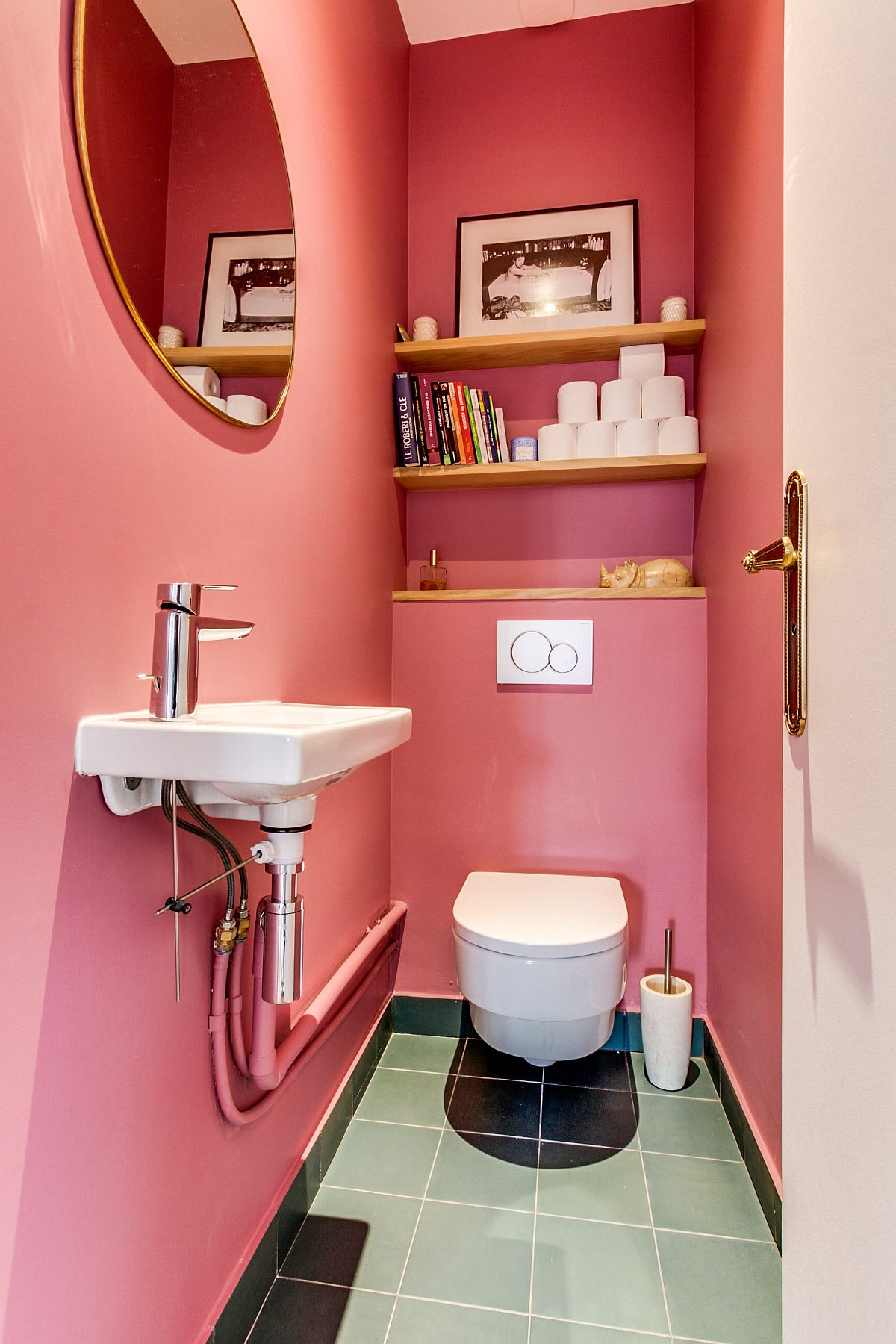Pink and snazzy powder room with glossy tiles that bring brightness to the space