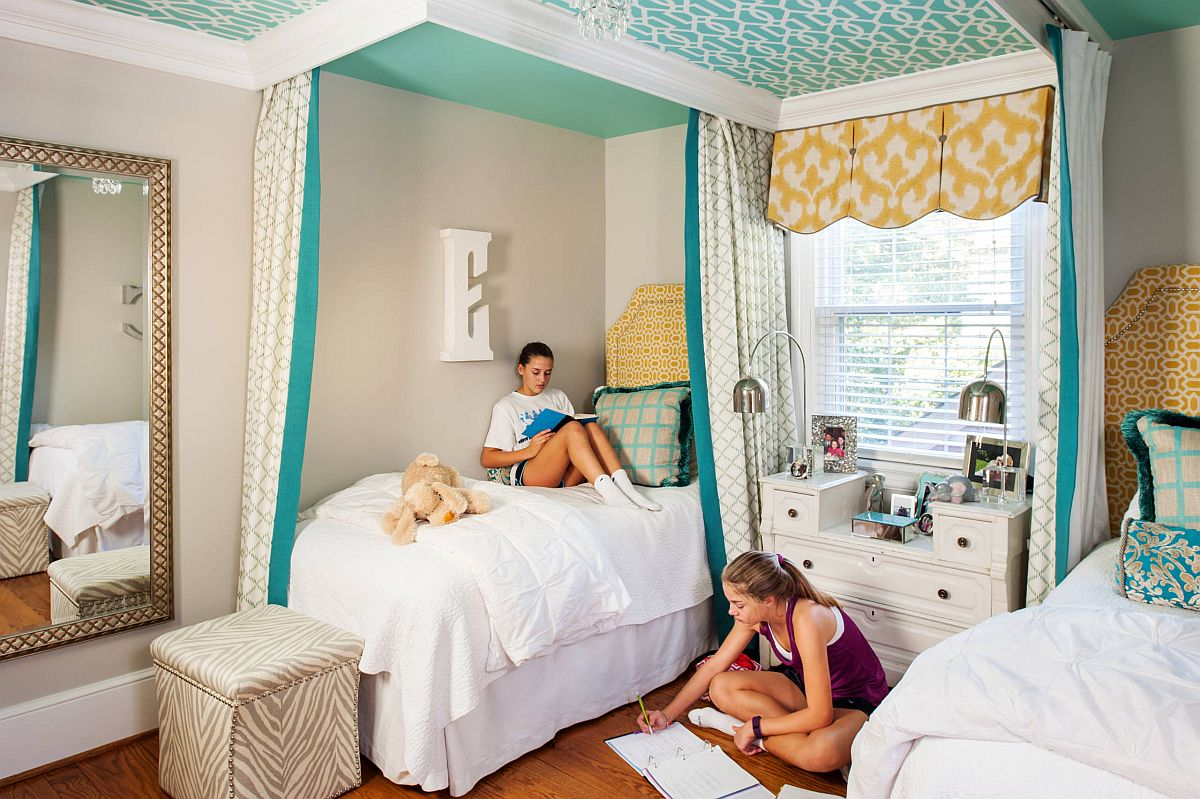 Placing one of the beds in the corner creates more space in the shared teen bedroom