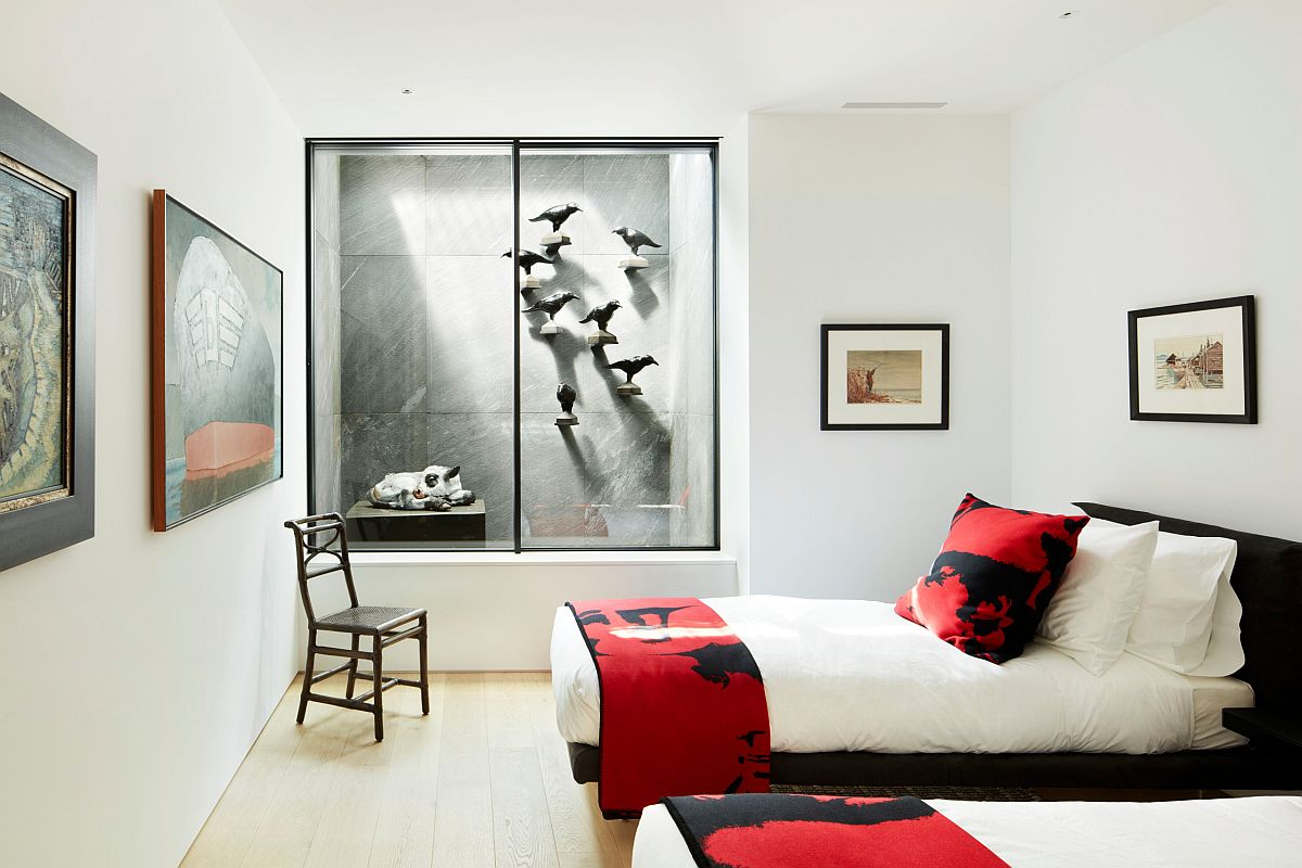 Polished teen bedroom in white with dazzling splashes of red brought in by bed sheets