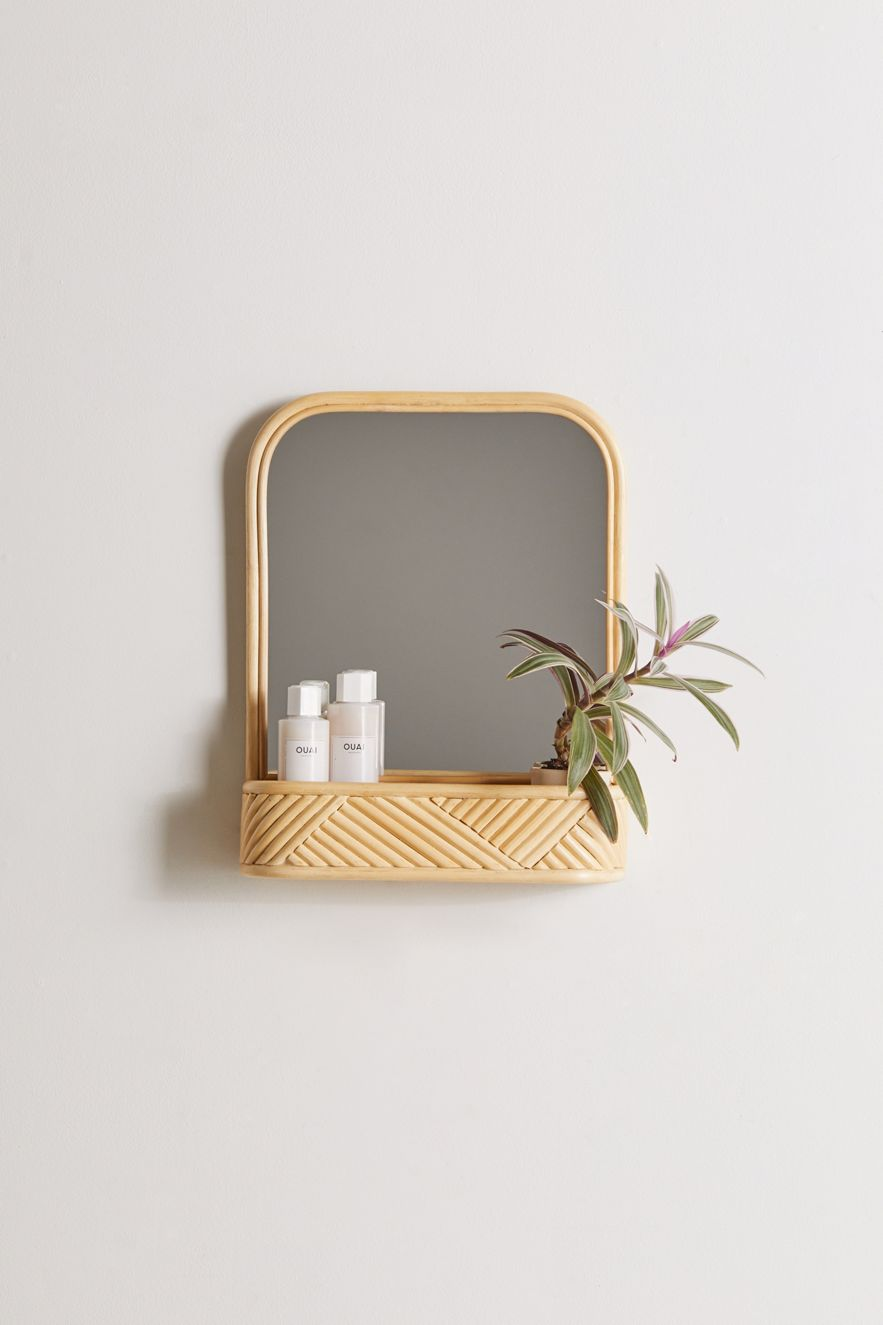 Rattan mirror with a built-in shelf