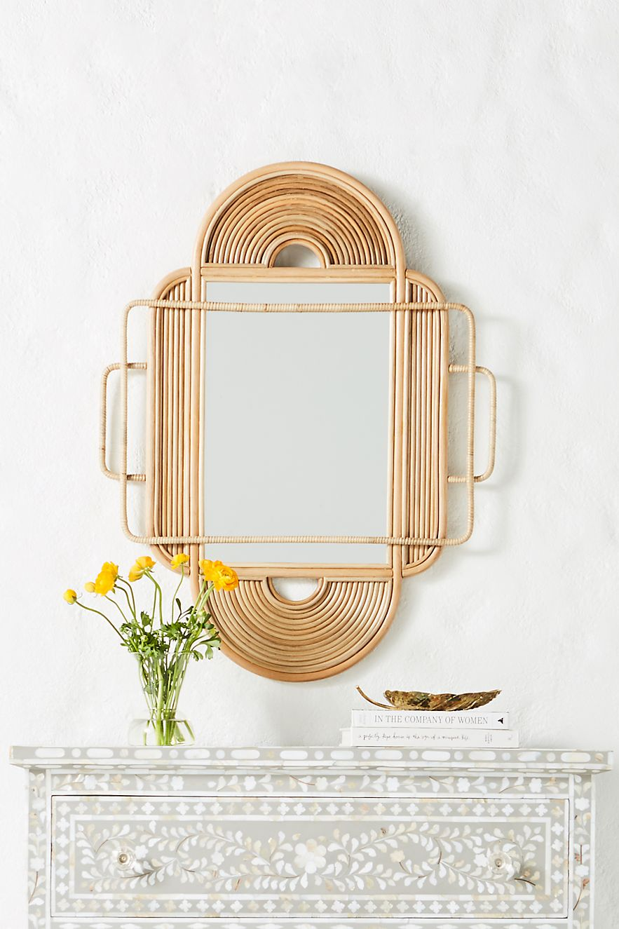 Rattan mirror with sculptural curves