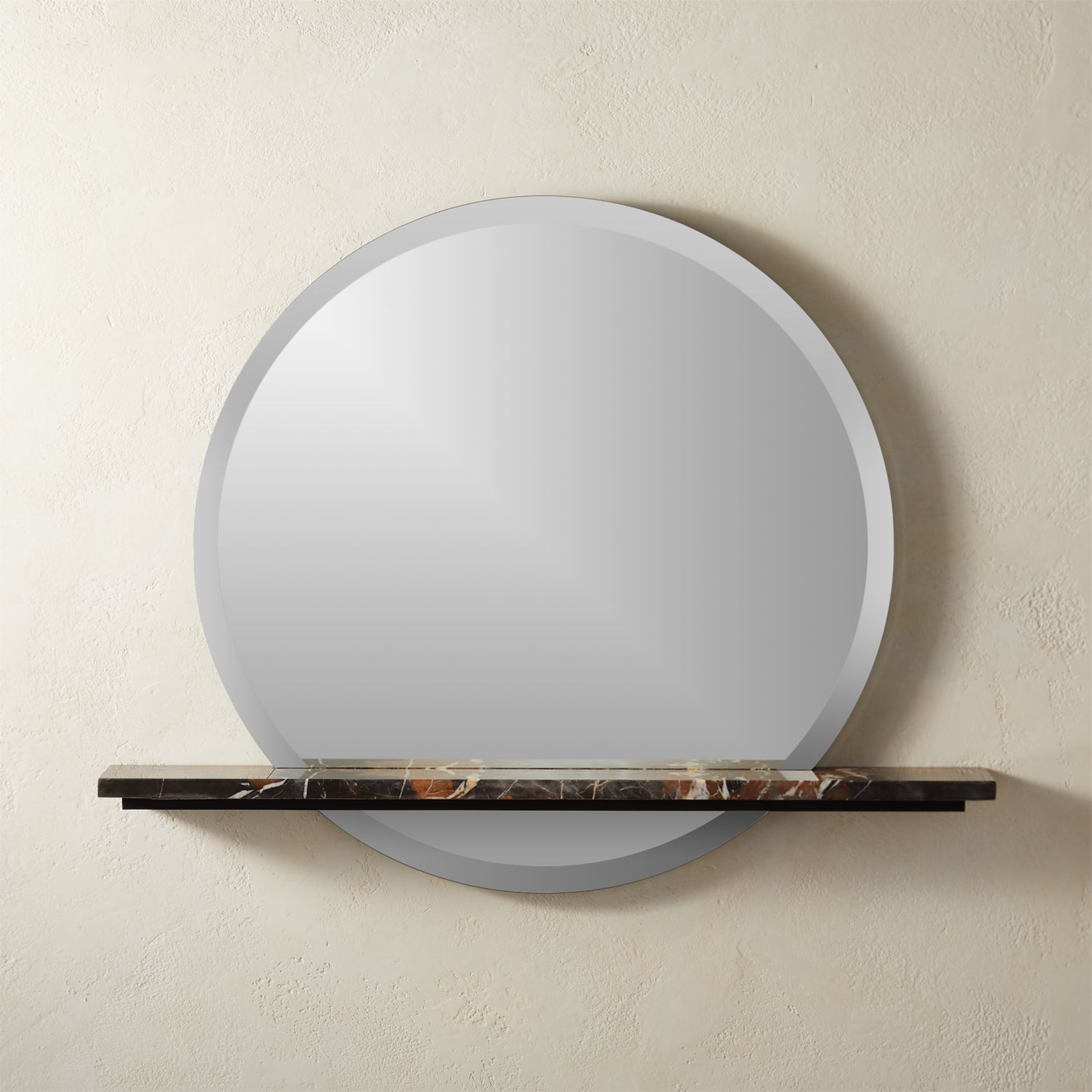 Round mirror with a marble shelf