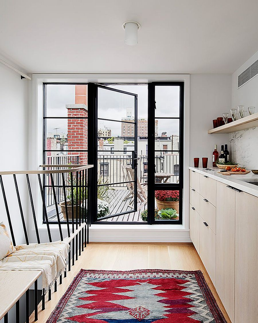 Rug-in-red-brings-a-bright-splash-of-color-to-this-kitchen-in-white-inside-classic-NYC-townhouse-33116