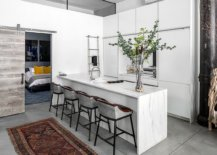 SLiding-barn-door-connects-the-elegant-little-kitchen-with-the-bedroom-next-to-it-22736-217x155