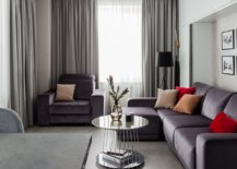 Sectional-in-gray-adds-to-the-color-scheme-of-the-tiny-living-room-with-red-accents-20858-217x155