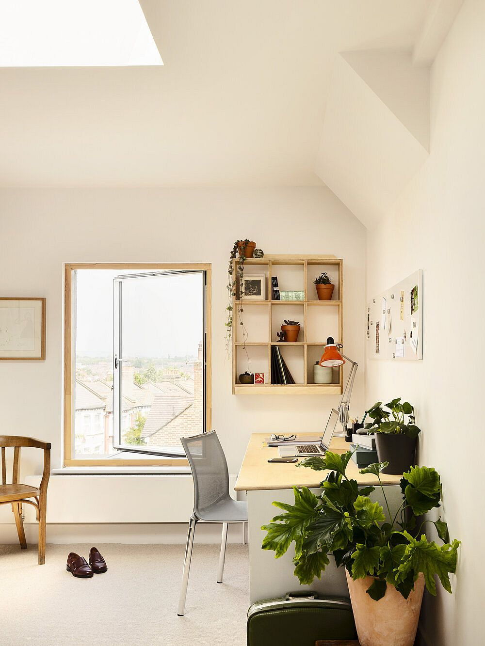Skylight, windows and sconce lights illuminate the upper level home office