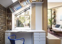 Slanted-shelves-and-birch-cabinets-create-a-home-workspace-out-of-the-tiny-corner-61628-217x155