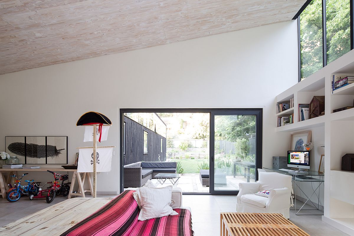 Sliding-doors-with-dark-frame-connects-the-spacious-living-area-with-the-patio-outside-63491