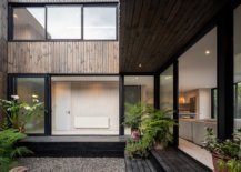 Sliding-glass-doors-with-steel-frame-and-wood-shape-the-exterior-of-the-house-12879-217x155