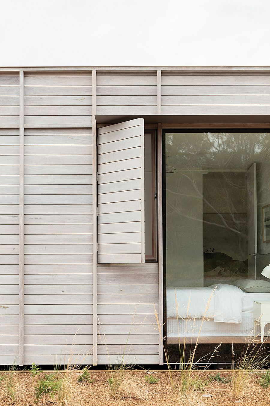 Sliding-screens-and-windows-open-up-to-connect-the-interior-with-the-landscape-outside-57330