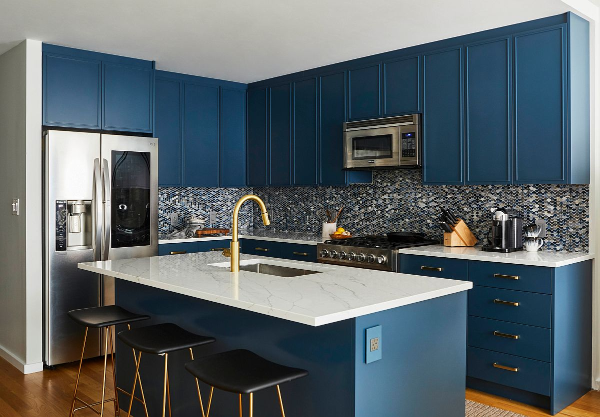 Small and stylish contemporary kitchen with dark blue cabinets and kitchen island alongw ith white countertops