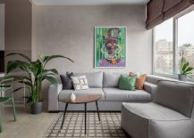 Small-and-trendy-eclectic-living-room-in-gray-where-accent-pillows-and-wall-art-usher-in-color-38637-217x155