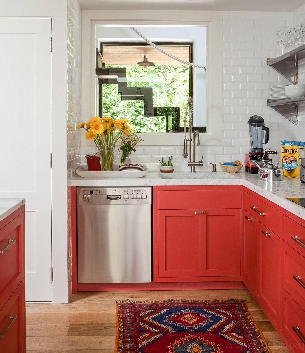 Small-beach-style-kitchen-with-bright-orangy-red-cabinets-and-white-backsplash-15505