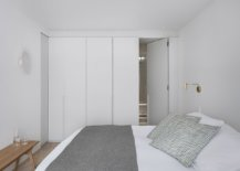 Small-bedroom-of-the-house-with-minimal-decor-and-white-walls-55469-217x155