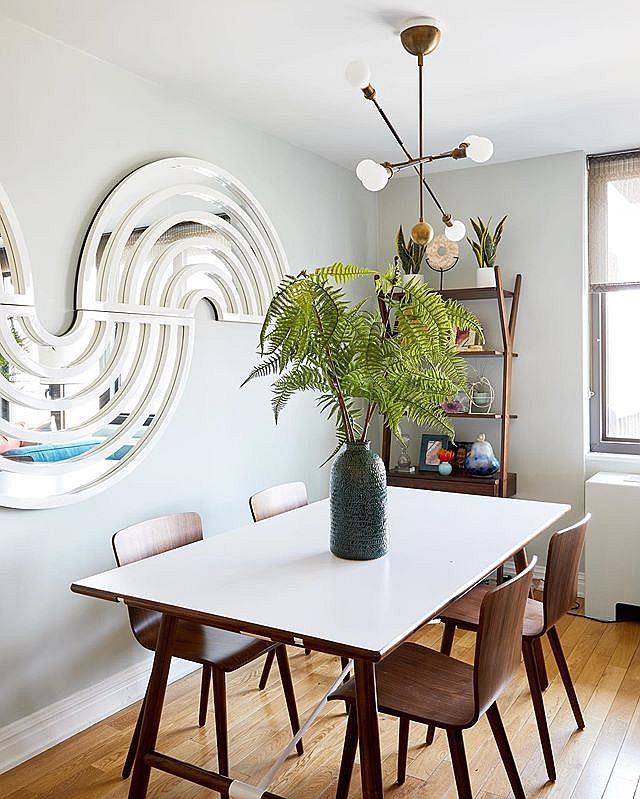 Small dining area of the Upper East Side Condo with wooden shelf in the corner