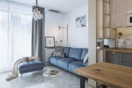 Navy Blue, Turquoise and Splashes of Yellow: Energetic Modern Bucharest Apartment