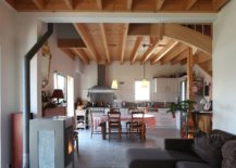 Social-dining-area-and-kitchen-of-he-house-with-vernacular-French-cabin-look