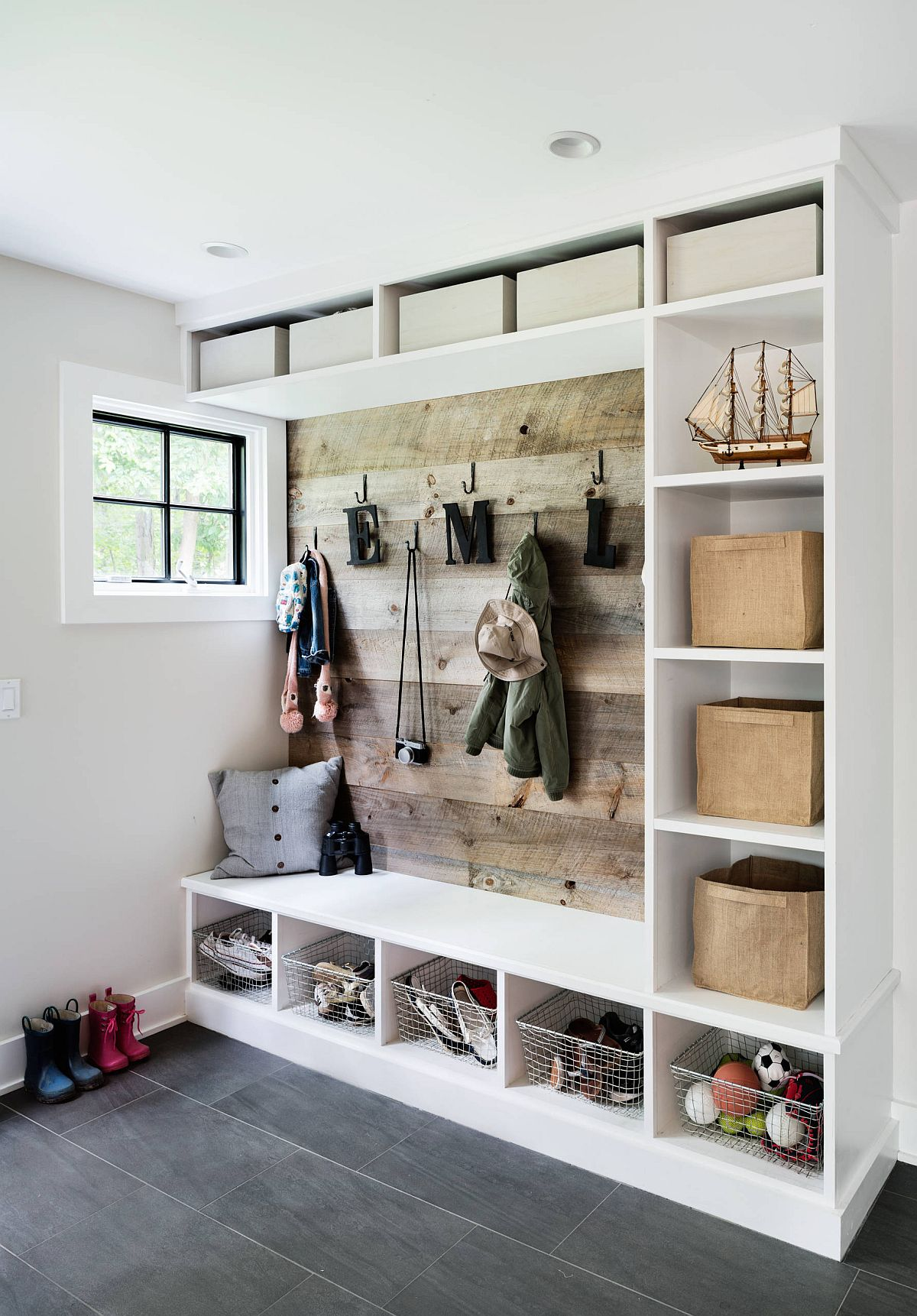 Space-savvy beach style mudroom in gray and wood with designated storage space for each person