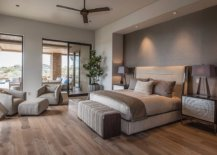 Spacious-bedroom-of-home-in-Phoenix-with-a-textured-gray-accent-wall-wooden-floor-and-striking-bedside-lamps-96348-217x155