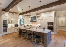 Spacious-wood-and-white-kitchen-of-the-house-with-wooden-ceiling-beam-and-ample-natural-light-96084-217x155