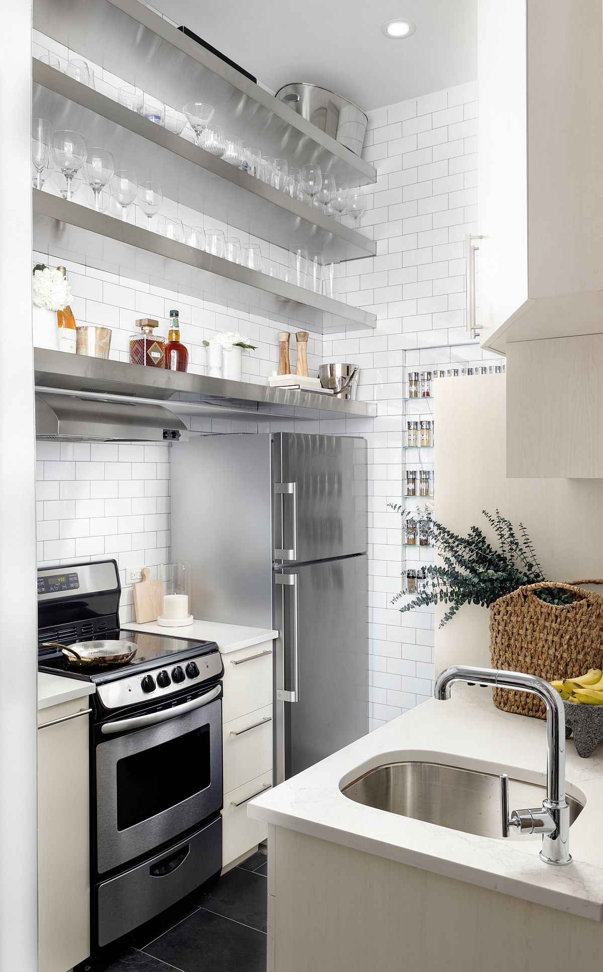 Stainless steel and white shape a fabulous and understated kitchen inside an apartment in Greenwich Village