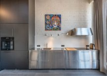 Stainless-steel-appliances-and-cabinets-bring-metallic-gloss-to-the-kitchen-with-white-brick-wall-53010-217x155