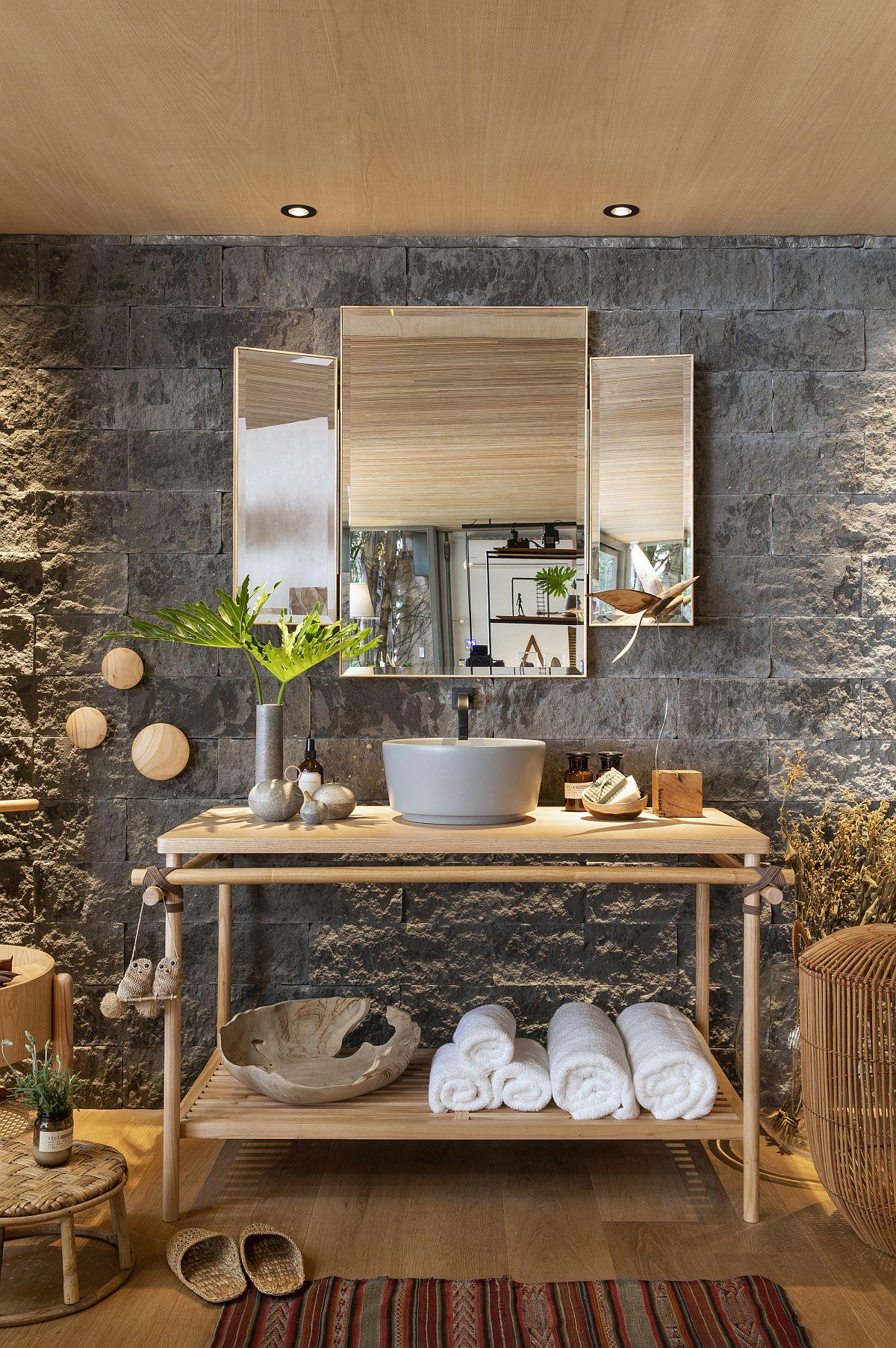 Stone walls fashion a unique backdrop in this smart bathroom