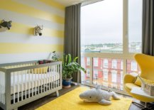 Striped-accent-wall-in-yellow-and-white-along-with-yellow-rug-and-chair-in-the-smart-modern-nursery-78865-217x155