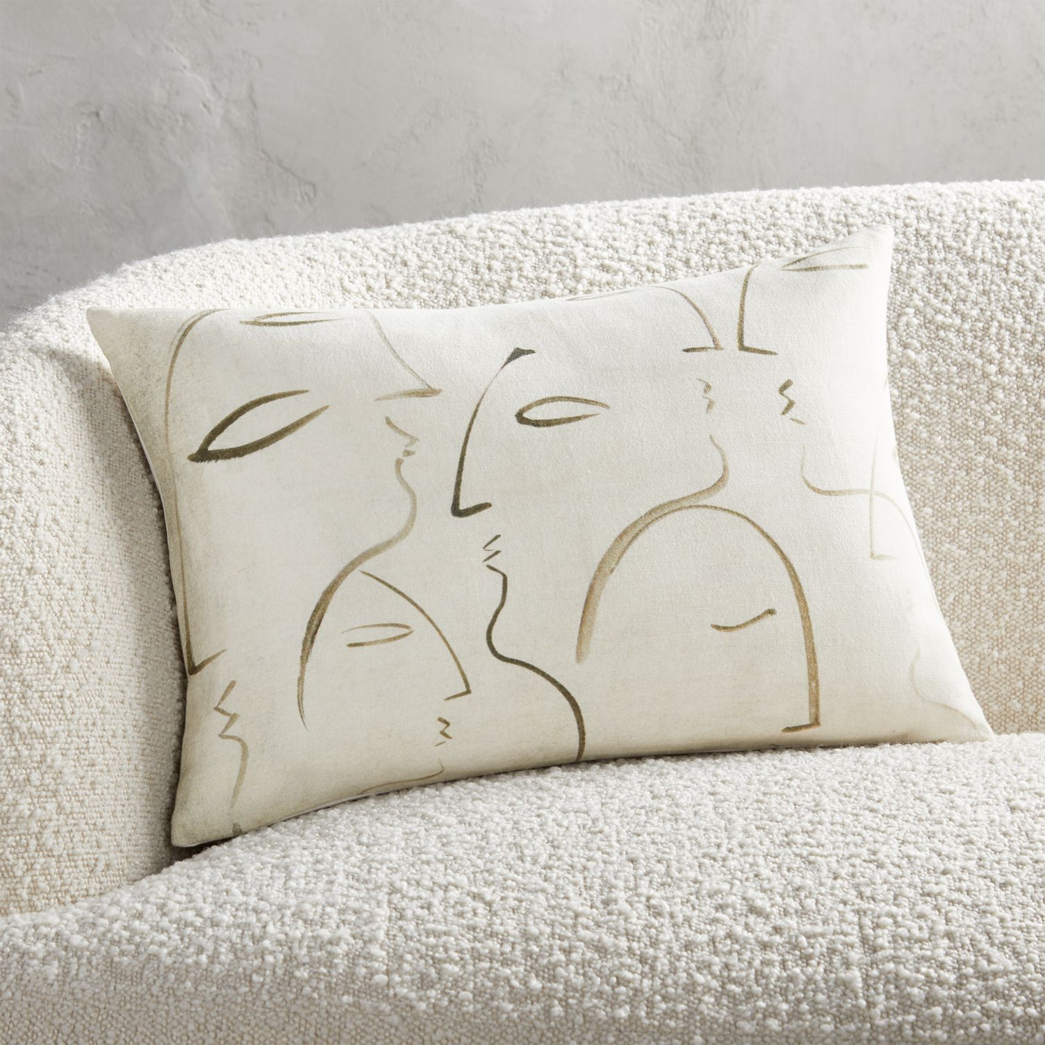 Throw pillow with line drawing faces