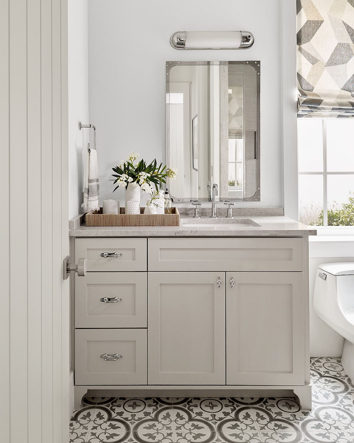 Tiles add pattern to the beach style bathroom without altering its color scheme