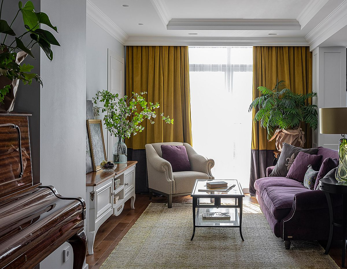 Traditional living room with limited space, bold purple couch and drapes in yellow