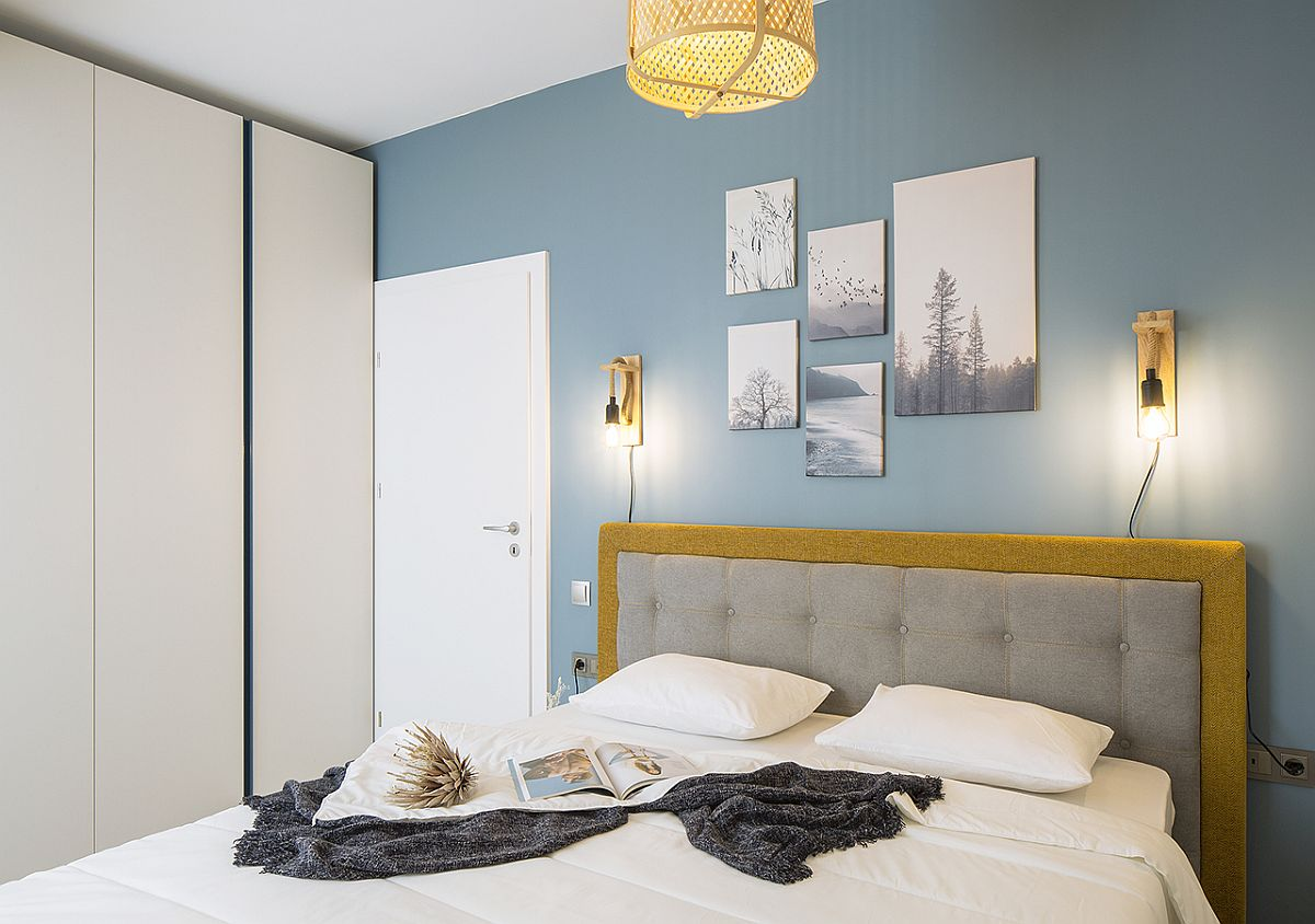 Tufted headboard brings an air of luxury to the bedroom in blue and white